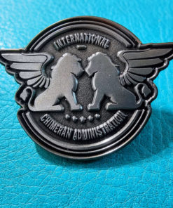 Pewter pin of the ICA logo with winged lions